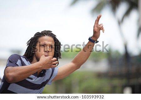 Man whistling and waving for a taxi