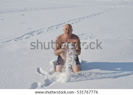 Man  wiping  snow  retirement  age,  to  promote  health