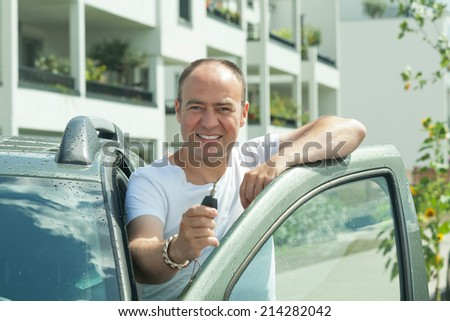man wit car key - stock photo