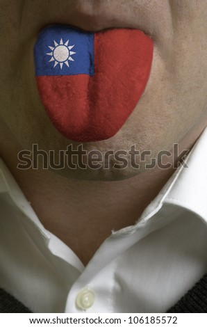 man wit open mouth spreading tongue colored in tajikistan flag as symbol of values like teaching, learning, multilingual speaking different of languages - stock photo