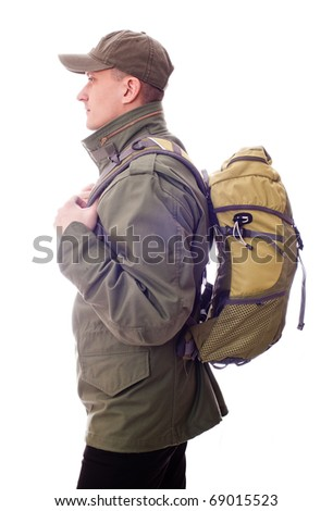 man with a backpack on his back - stock photo