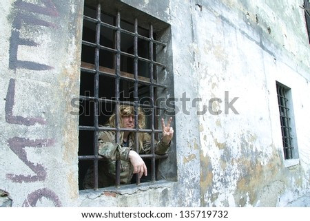 man with a barred window