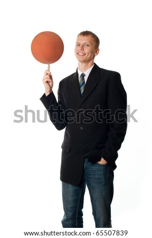 Man with a basketball on his finger - stock photo