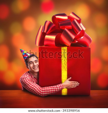 Man with a big gift - stock photo