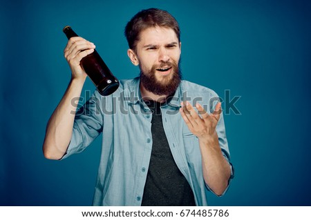 Man with a bottle of beer