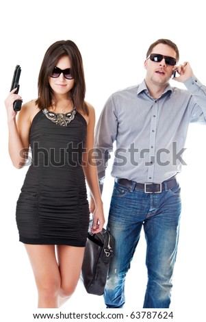 Man with a case speaks by phone and the woman with a gun