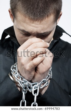 Man with a chained hands.