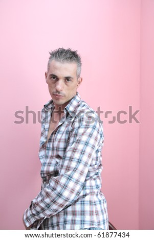 man with a checked shirt relaxed expression - stock photo