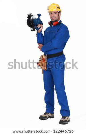 Man with a circular saw - stock photo