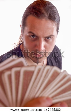 man with a deck of cards in his hand with a mystical look