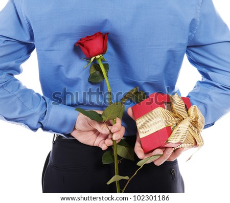 man with a gift box and a rose. Isolated on white background - stock photo