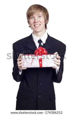 Man with a gift in his hands - stock photo