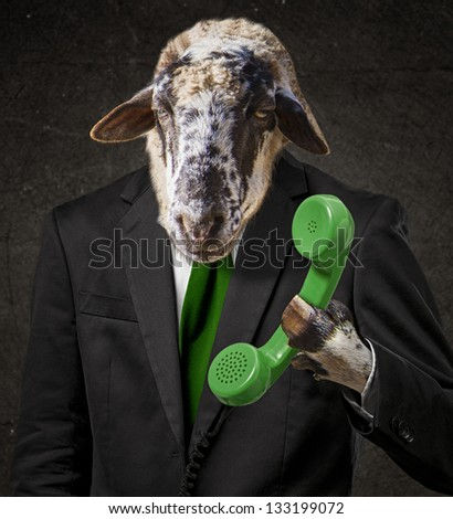 Man With A Goat Head Holding Telephone Receiver - stock photo