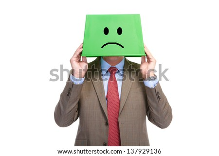 Man with a green box on a head, isolated over a white background  - stock photo