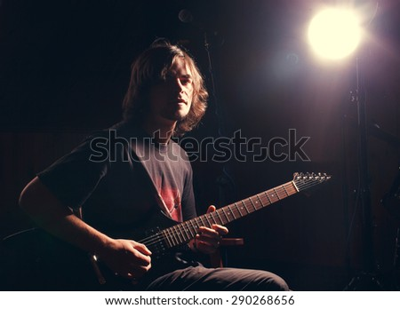 man with a guitar on the rock concert - stock photo