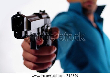 Man with a gun. - stock photo