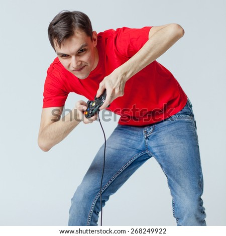 man with a joystick playing with passion - stock photo