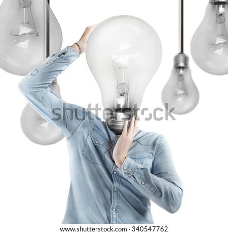 Man with a light bulb as head - stock photo