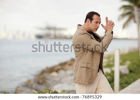 Man with a make believe handgun - stock photo