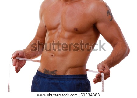 man with a muscular body measuring his abs
