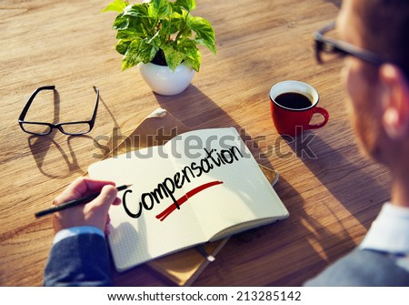 Man with a Note and a Single Word Compensation - stock photo