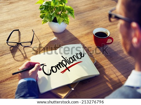 Man with a Note and a Single Word Compliance - stock photo
