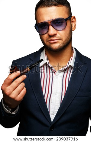 Man with a pipe in a stylish suit - stock photo