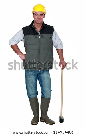 Man with a sledgehammer - stock photo