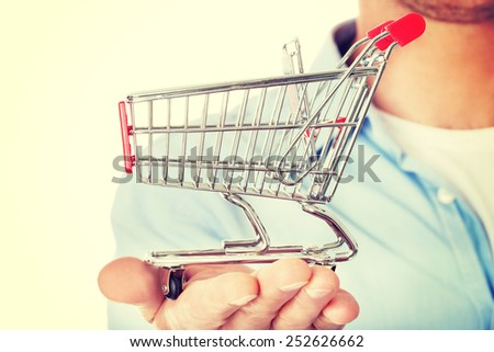Man with a small shopping basket. Ecommerse concept - stock photo