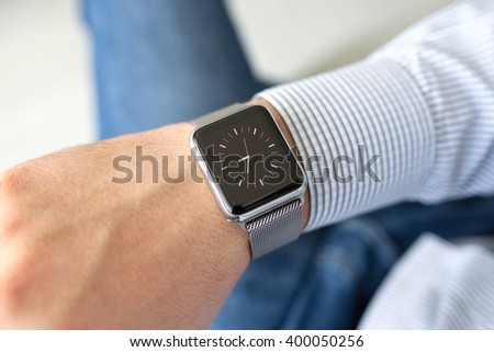 man with a smart watch on a hand and dial