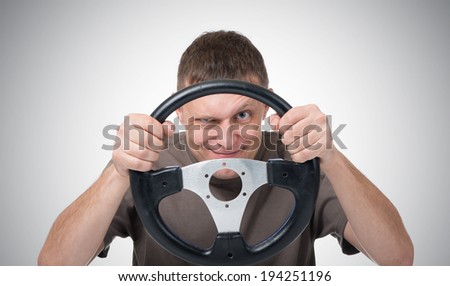 Man with a steering wheel, driver auto concept - stock photo