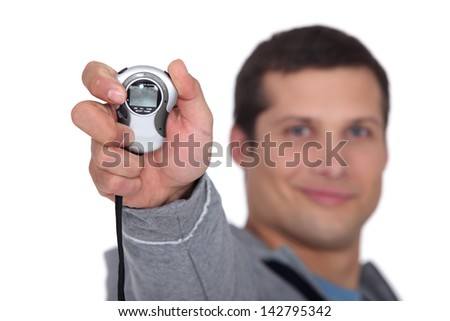 Man with a stopwatch - stock photo