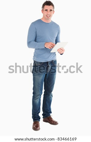 Man with a tablet computer against a white background - stock photo