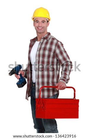 Man with a toolbox and powerdrill - stock photo