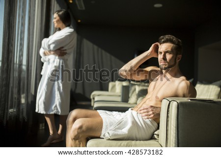 Man with a towel sitting in a room