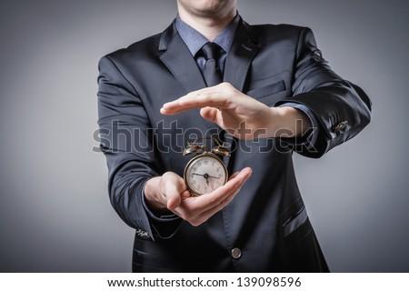Man with an alarm clock - stock photo