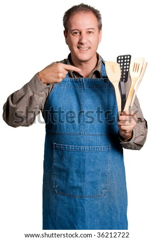 Man with an apron showing cooking tools against a white background