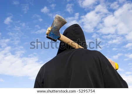 man with an axe on sky background