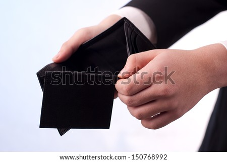 Man with an empty black wallet