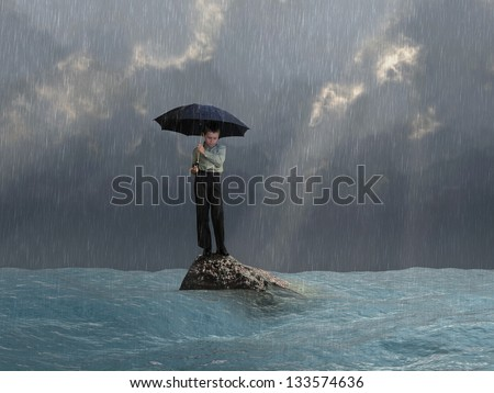 man with an umbrella in the flood - stock photo