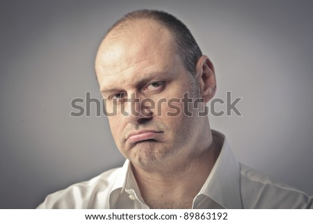 Man with annoyed expression - stock photo