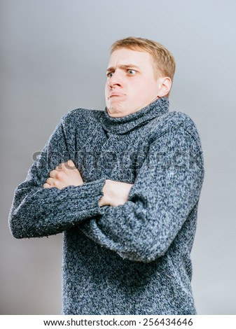man with annoyed face expression, isolated grey wall background. Human emotions, feelings, body language, life perception, attitude - stock photo