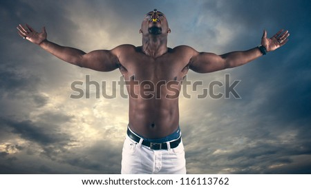 Man with arms in air - stock photo