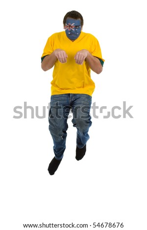 man with australian shirt and australian flag on his face pretending to be a kangaroo, jumping isolated on white background - stock photo