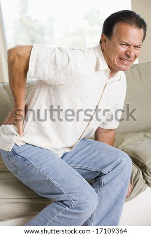 Man With Back Pain - stock photo