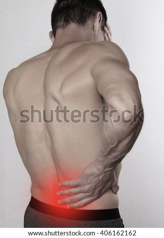 Man with back pain. Pain relief,  chiropractic concept - stock photo