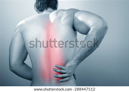 Man with backache - stock photo