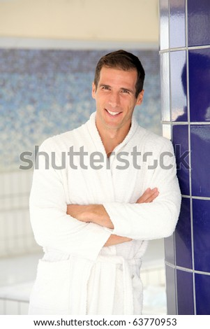 Man with bathrobe standing by spa pool