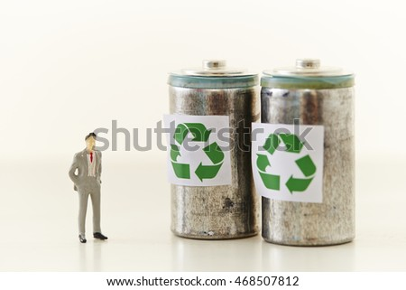 Man with battery with recycling symbol