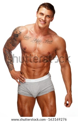 Man with beautiful muscular tattooed torso in underwear  - stock photo